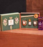 Song of India Rakhi Gift Set with 2 pcs of Scented Soy Votive Candles, Reed Diffuser with Sticks, Handmade Rakhi with Roli - Chaval Thali and Dairy Milk Chocolate, Packed in Beautiful and Compact Sea Green Gift Box